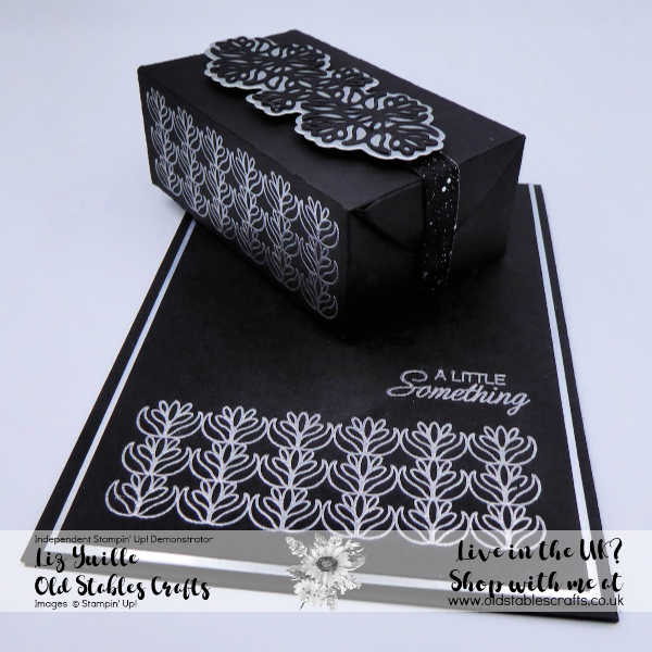Petals and Parcels silver embossing on black card